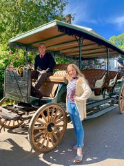 Katharine Witt poses with carriage tour driver Chad Bennett on Mackinac Island.