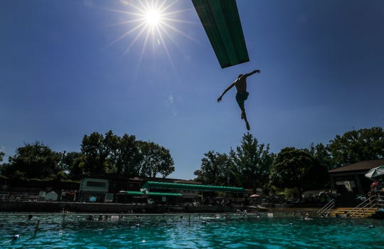 Swimmers go off the diving boards at Lakeside Swim Club on Thursday afternoon.July 18, 2019