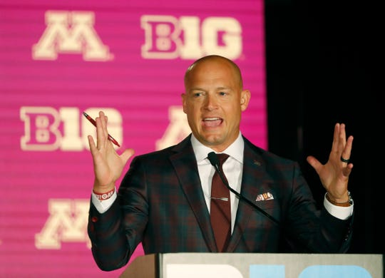 Minnesota head coach P.J. Fleck responds to a question during the Big Ten Conference NCAA college football media days Thursday, July 18, 2019, in Chicago. (AP Photo/Charles Rex Arbogast)