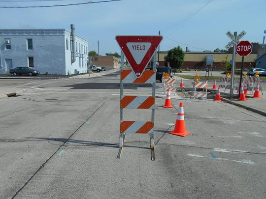 A yield sign in downtown Manitowoc.
