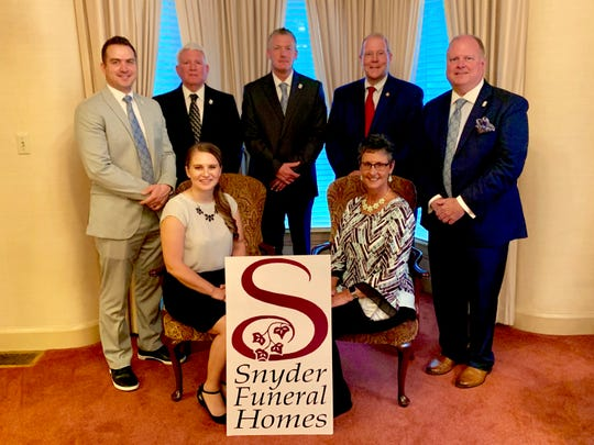 The Lyndsey Funeral Home is now part of the Snyder family of Funeral Homes. From left, front row: Kris Buirley, Ashley Buirley, Kim Lindsey, J. Todd Snyder; Back Row: Dennis Snyder, Wes Snyder, Walt Lindsey.