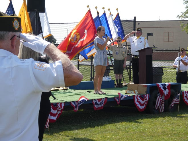 The national anthem is sung at the opening ceremony of The Wall That Heals, a replica of the Vietnam Veterans Memorial in Washington D.C., which is open 24 hours a day at River Valley High School until 3 p.m. Sunday.