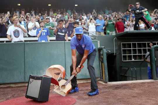 Memphis Tigers Basketball Head Coach Penny Hardaway smashes a guitar before the 901 FC takes on Nashville SC at AutoZone Park on Wednesday, July 17, 2019.