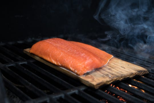 Cooking salmon on cedar planks imparts an extra layer of flavor.