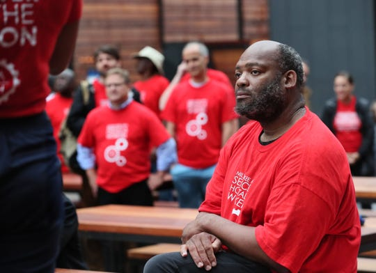 Corey Moye listens to speakers at a rally held by Milwaukee Area Service and Hospitality Workers on Thursday.