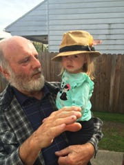 Stephen Matasic holds his grandchild, Berlin, before having a stroke he never recovered from.