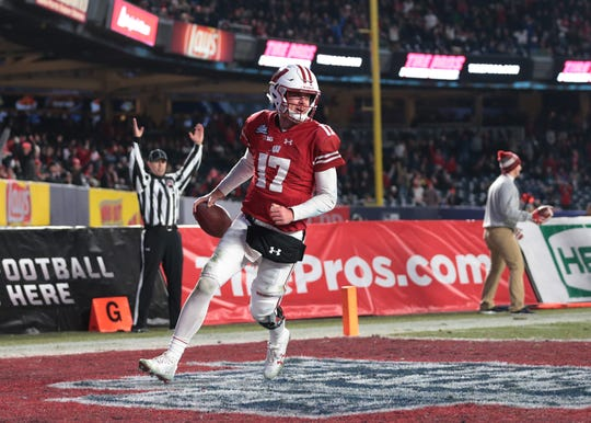 Wisconsin Badgers quarterback Jack Coan rushes for a touchdown during the second half of the 2018 Pinstripe Bowl against the Miami Hurricanes at Yankee Stadium on Dec 27, 2018.