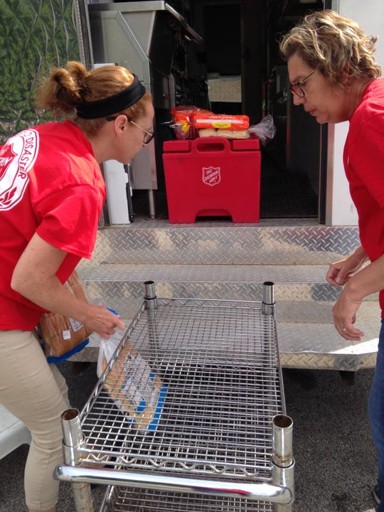 Salvation Army of Mountain Home volunteers (from left) Christy Esely and Lisa Webb load up items into their canteen last month in eastern Oklahoma. The Salvation Army deployed a crew of local volunteers to Oklahoma last month following the flooding of the Arkansas River.