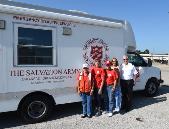 Members of the Salvation Army disaster relief team that recently deployed to eastern Oklahoma poses Thursday with the organization's canteen. Team members include (from left) Joanne Losurdo, Lisa Webb, Gil Losurdo, Christy Esely and Maj. Ernie Branscum, commanding officer of the Salvation Army of Mountain Home.