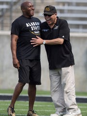 Former Alabama State University head coach Reggie Barlow hugs his former coach at ASU Houston Markham during the Alabama State Black and Gold Game at Hornet Stadium on the ASU campus in Montgomery, Ala. on Saturday April 28, 2018.