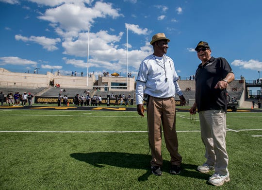 Alabama State University head football coach Donald Hill-Eley, left, chats with former ASU head coach Houston Markham, right, during the Alabama State Black and Gold Game at Hornet Stadium on the ASU campus in Montgomery, Ala. on Saturday April 28, 2018.