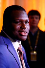 Auburn defensive end Marlon Davidson speaks to reporters during the NCAA college football Southeastern Conference Media Days, Thursday, July 18, 2019, in Hoover, Ala. (AP Photo/Butch Dill)