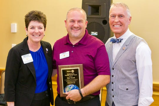 Matt Howell (center), 2019 recipient of the Merrill Greene Award, poses with current Muncie Rotary president Kelly Shrock (at left) and  Dale Basham, immediate-past District 6560 governor.