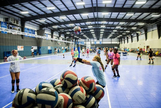 Munciana volleyball players practice during a summer camp at the Yorktown Sports Park.