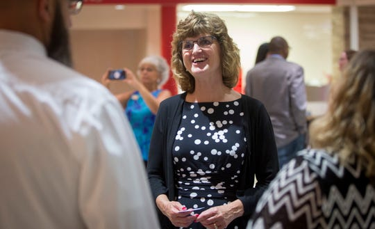 Lee Ann Kwiatkowski talks with members of the public on July 16 at Muncie's Southside Middle School during an open house. Kwiatkowski was selected as the new Director of Public Education and CEO of Muncie Community Schools.