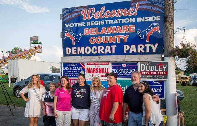 """Democrat candidates pose for a photo with the Fair Queen and court during """"Democrat Night"""" on Wednesday at the Delaware County Fair. The annual event is a way for candidates to meet the public in an informal fashion."""