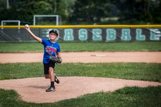 A child practices pitching at the Yorktown Sports Park.
