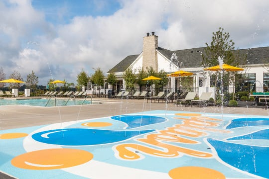 The pool and splash pad are popular features in Durham Farms, one of the growing number of lifestyle neighborhoods in the Nashville region.