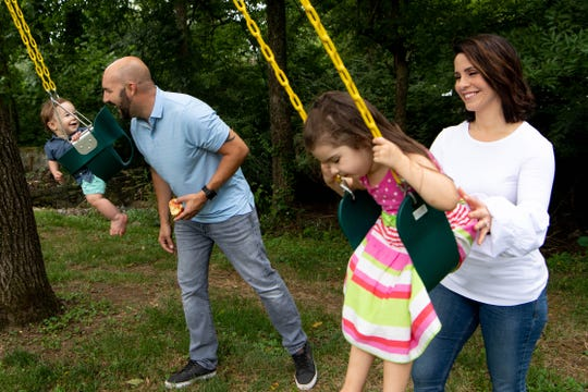Channel 4 anchor Lauren Lowrey and her husband, Blake Lewis, push their children, Landon and Samantha, on the swings at their home July 18, 2019.