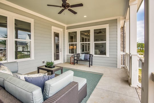 The back porch of this Celebration Homes house in Stephens Valley is a comfortable place to enjoy the outdoors.