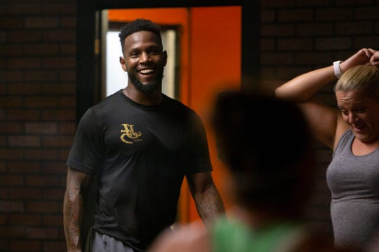 Former NFL running back and Immokalee High School football star Javarris James works with his clients during a boot camp fitness class, Wednesday, July 17, 2019, at his gym, JJ5 Fitness in North Naples.