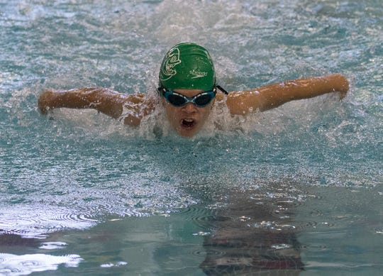 Nolan Schneider swims the butterfly for the Moundbuilders Piranhas in the 11-12 100 individual medley Thursday during the Tri-County Aquatic League championships at Denison.