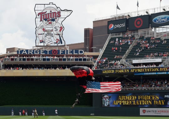 """Jeff McNeil said the wall at Target Field is hard, leading to more impactful bounces. """"It's kind of instincts,"""" McNeil said of knowing bounces. Here a parachuter lands at Target Field before a game between the Minnesota Twins and the Texas Rangers on July 7, 2019 at Target Field in Minneapolis, Minnesota."""