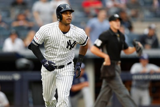 New York Yankees' Aaron Hicks watches his solo home run during the sixth inning of the first game of a baseball doubleheader against the Tampa Bay Rays, Thursday, July 18, 2019, in New York.
