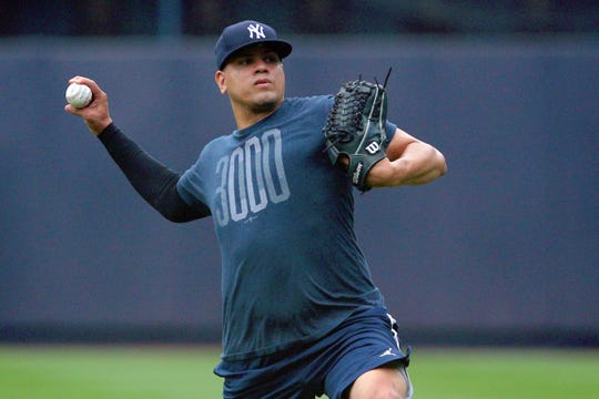 Jul 18, 2019; Bronx, NY, USA; New York Yankees injured relief pitcher Dellin Betances (68) throws in the outfield before the first game of a doubleheader against the Tampa Bay Rays at Yankee Stadium.