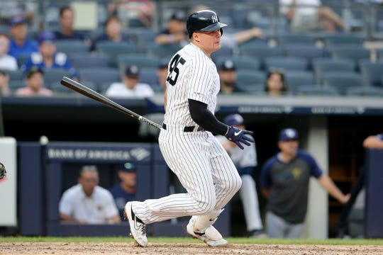 Jul 18, 2019; Bronx, NY, USA; New York Yankees first baseman Luke Voit (45) follows through on an RBI single against the Tampa Bay Rays during the fifth inning of the first game of a doubleheader at Yankee Stadium.