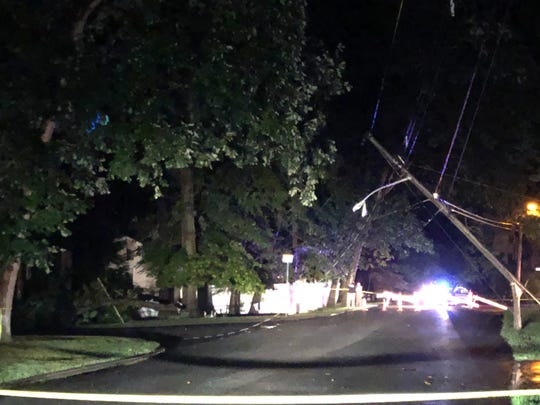 A tree fell on Everdell Avenue in Hillsdale, NJ taking down a pole and power lines on Wednesday, July 17, 2019.