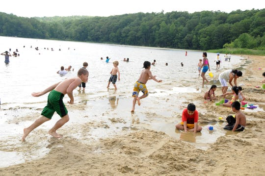 A Saturday at Wawayanda State Park in full summer mode as kids run along the shoreline, swim, and dig sand castles.