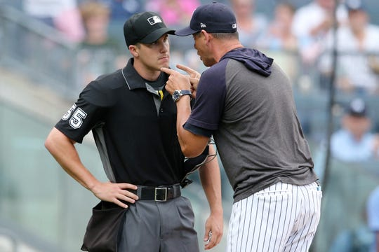 Jul 18, 2019; Bronx, NY, USA; New York Yankees manager Aaron Boone (17) argues with home plate umpire Brennan Miller (55) after being ejected during the second inning of the first game of a doubleheader against the Tampa Bay Rays at Yankee Stadium.
