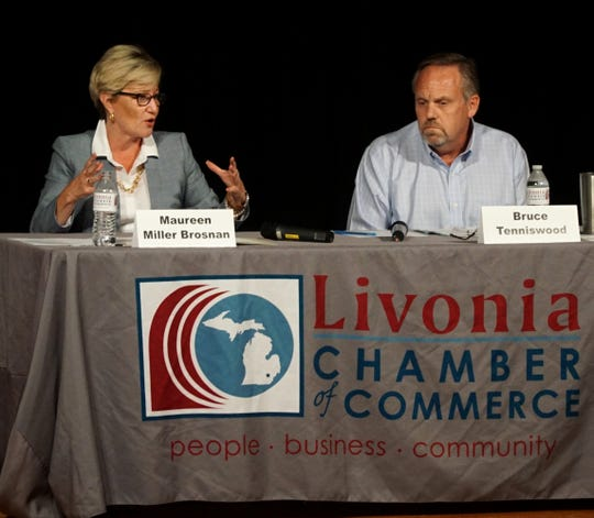 Maureen Miller Brosnan and Bruce Tenniswood answer audience questions in a debate for the Livonia Mayor's position.