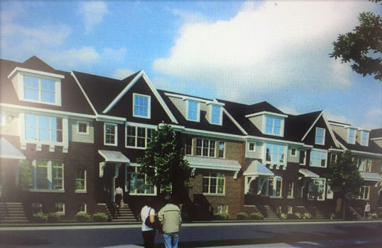A rendering looking northeast at the town homes that would line Maple Street.