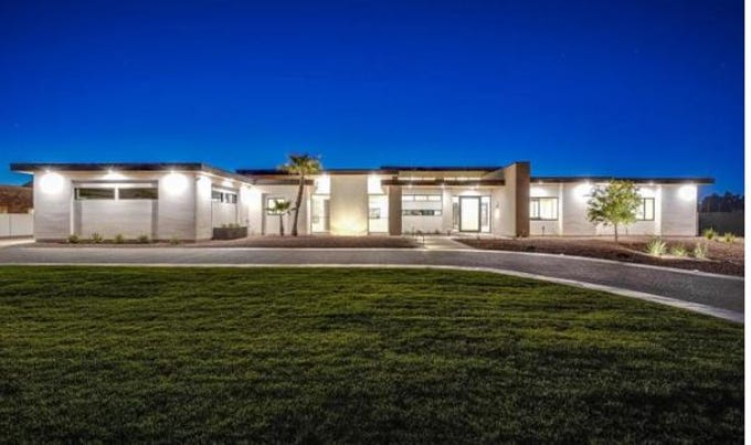 Cody Alt purchased this new construction mansion in Paradise Valley's Berneil Ranchos community for $3.3M.