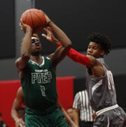 Compass Prep's Jalin Anderson (0) goes up for a shot against Veritas Ismael Cruz (10) during a game at the PHHacility in Phoenix, Ariz. on October 14, 2018.