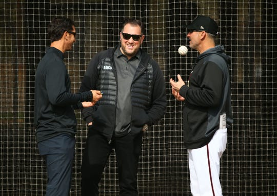 Arizona Diamondbacks GM Mike Hazen, Jared Porter senior VP & assistant GM and manager Torey Lovullo during the first day of spring training workouts on Feb. 13 at Salt River Fields in Scottsdale.