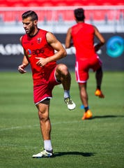 Joey Calistri of Phoenix Rising FC warms up before a practice on July 9.