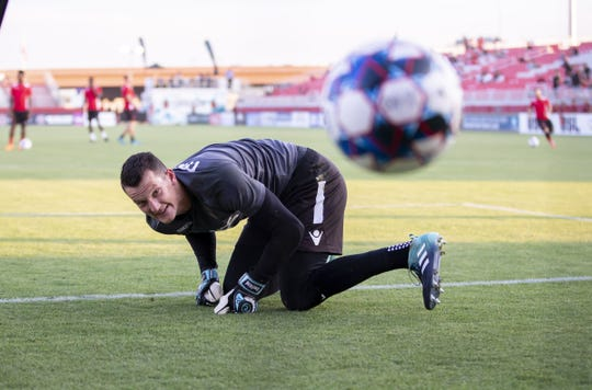 Phoenix Rising FC goalkeeper Zac Lubin  warms before a game against Las Vegas Lights FC on June 13, 2018.