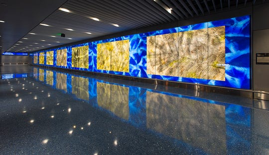 """Phoenix public art: """"Trace Elements"""" (2012) by Daniel Mayer of Tempe greets passengers as they cross the bridge from the Sky Train to Terminal 4 at Phoenix Sky Harbor."""