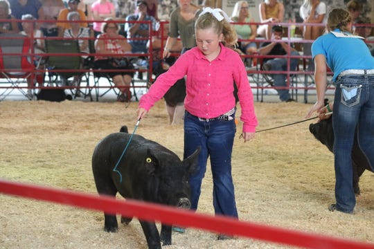 Karmela Neiderhouse, a member of the Salem All Stars club in Oak Harbor, earned her hog the second-place finish in the middleweight division.