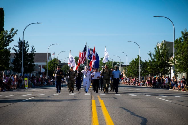 A color guard marches in formation down the center of Huron Avenue Wednesday, July 17, 2019, during the Rotary International Parade in Port Huron.