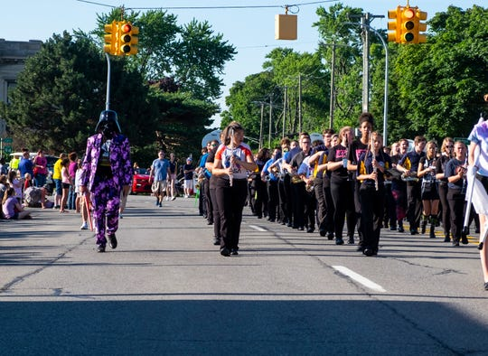 The Port Huron Northern Marching Band wears space and Star Wars-themed outfits as they march down Huron Avenue Wednesday, July 17, 2019, during the Rotary International Parade in Port Huron.