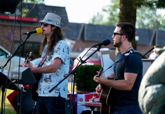 Todd Armstrong, right, and Brandon Pavlov perform as The Revivors at a city event in St. Clair's Palmer Park Thursday, July 18, 2019. The two were teammates with Riley Gleason during their time at St. Clair High School and performed at a city event that turned into a fundraiser for the Gleason family.