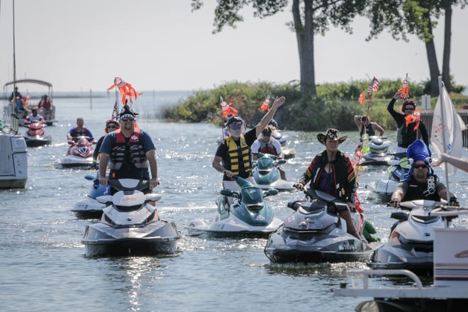 Participants float together during the Water Warriors Mackinaw Ride on  July 27, 2016.