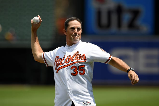 Former Baltimore Orioles pitcher Mike Mussina throws out the ceremonial first pitch before a baseball game between the Baltimore Orioles and the Cleveland Indians, Sunday, June 30, 2019, in Baltimore. Sunday, Mussina will be inducted into the Baseball Hall of Fame. (AP Photo/Nick Wass)