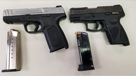 Two semi-automatic handguns, one of which was reported stolen, seized by police as they searched for Khalic Cross, wanted in York for shooting a woman at a city cookout.