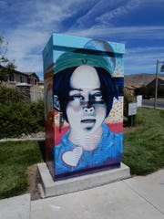 Breanna Brown's artwork on the signal box at Steamboat Parkway and Veterans Parkway.