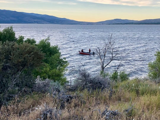 Divers from the Washoe County Sheriff's Office HASTY team and from the Truckee Meadows Fire Protection District search for a missing kayaker in Washoe Lake on Wednesday, July 17.